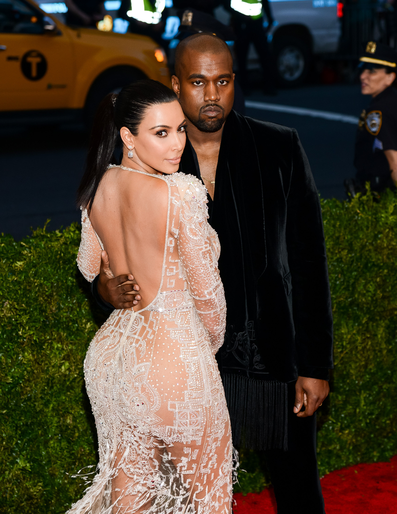 A photo of Kim Kardashian and Kanye West on the red carpet.