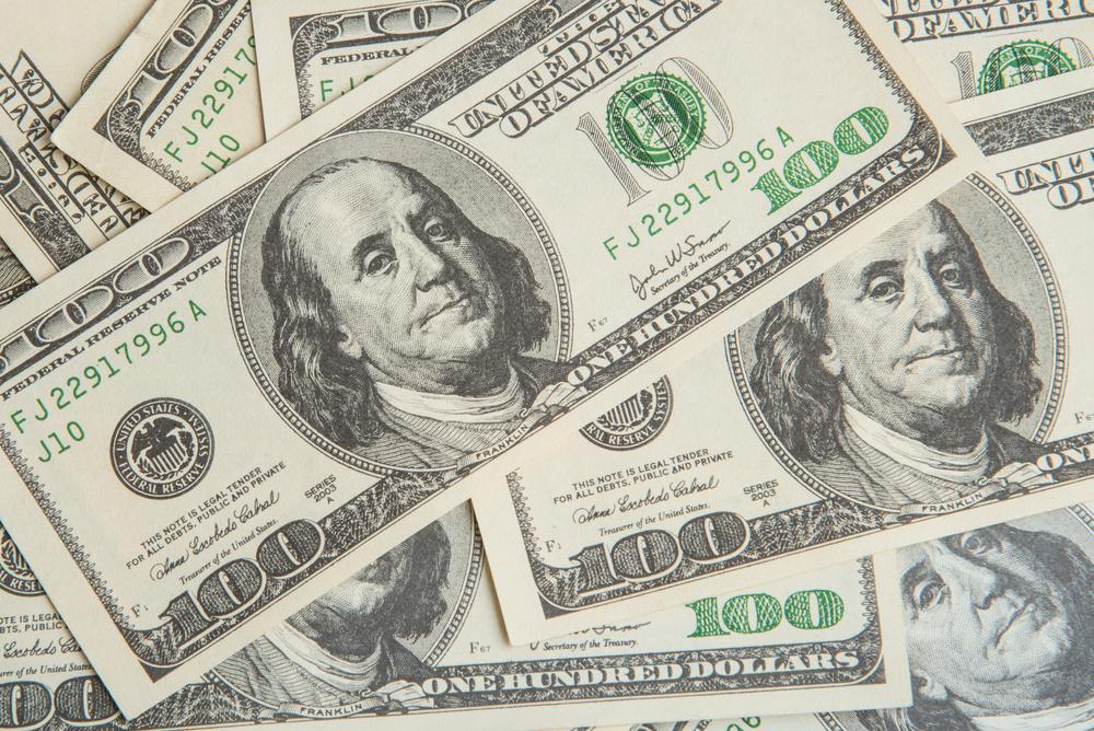 A photo of several hundred dollar bills.