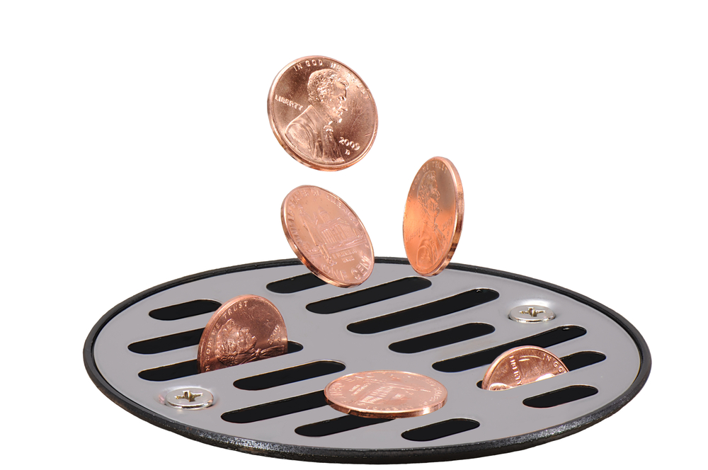 Pennies being dumped down the drain.