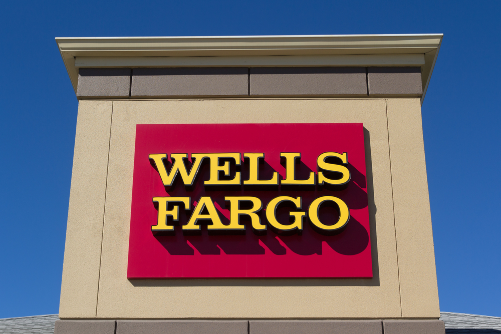 A photo of the Wells Fargo logo placated on a building.