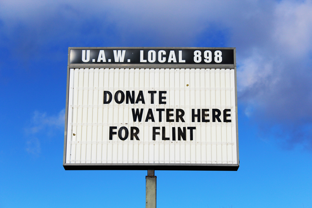 A sign asking for donations for the Flint water crisis.