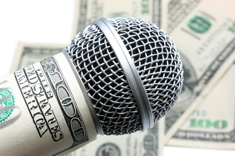 A microphone surrounded by money.