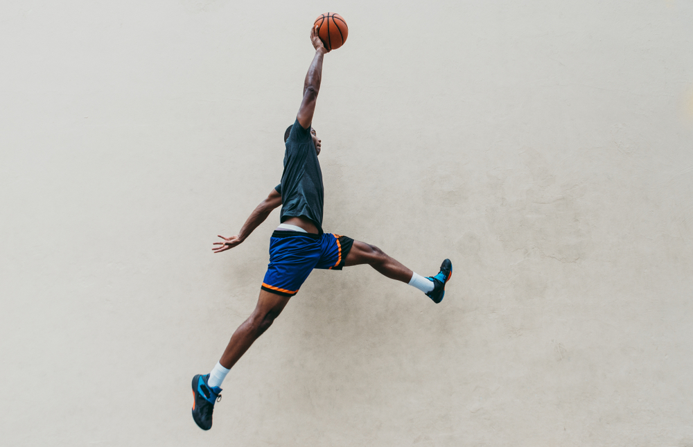 a basketball player jumps in signature Michael Jordan pose